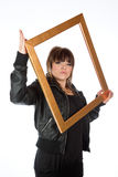 Pretty young girl holding a picture frame Stock Images