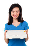 Pretty young girl holding pizza box Stock Image