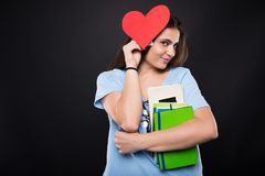 Pretty young college girl holding red paper heart Stock Photography