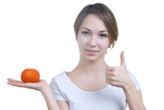 Pretty young girl holding red tomato showing ok Stock Photography