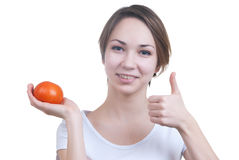 Pretty young girl holding red tomato showing ok Royalty Free Stock Photo