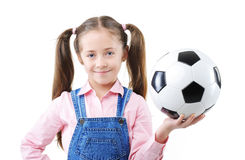 Pretty young girl holding a soccer ball Stock Image