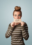 Pretty young girl holding white card with smile drawing Stock Image