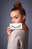 Pretty young girl holding white card with smile drawing Stock Photography