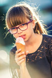 Pretty young girl with ice cream. Stock Photo