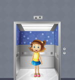A pretty young girl inside the elevator Stock Image