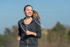 Pretty young girl  jogging Stock Photos