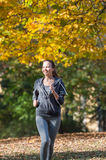 Pretty young girl  jogging Royalty Free Stock Image
