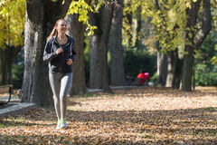 Pretty young girl  jogging Royalty Free Stock Photography
