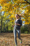 Pretty young girl  jogging Royalty Free Stock Images