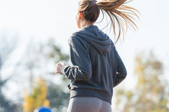 Pretty young girl  jogging Stock Image