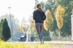 Pretty young girl  jogging Stock Photos