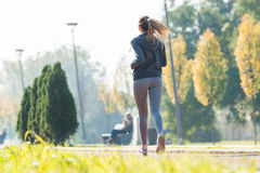 Pretty young girl  jogging Royalty Free Stock Photos