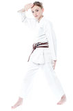 Pretty young girl in karate uniform Stock Photos