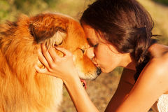 Pretty Young Girl Kisses Her Cute Dog Royalty Free Stock Images