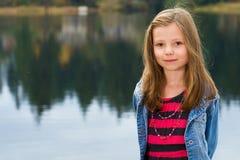Pretty young girl at a lake Stock Photos