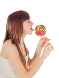 Pretty Young girl licking a lollipop Royalty Free Stock Photo
