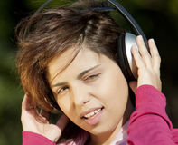 Pretty young girl listening music Royalty Free Stock Image