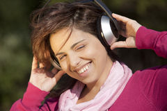 Pretty young girl listening music Stock Photo