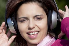 Pretty young girl listening music Stock Photography