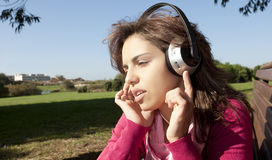 Pretty young girl listening music Stock Images