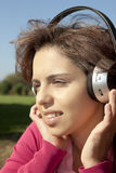 Pretty young girl listening music Royalty Free Stock Photo