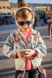 Happy girl child listen to the music from her smartphone Royalty Free Stock Photos