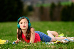A pretty young girl listening to music Royalty Free Stock Image