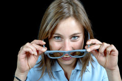 A pretty young girl looking at with 3d glasses Stock Photo