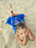 Pretty young girl lying on the beach Stock Photos