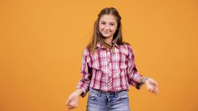 Pretty young girl making silly happy faces stock footage