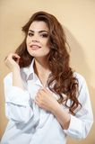 Pretty young girl in modern white blouse Stock Images