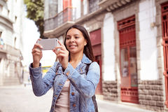 Pretty young girl in a narrow street Royalty Free Stock Image