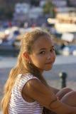 Pretty young girl near the Mediterranean sea looking forward . Antalya, Turkey, marina Stock Photos