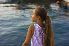 Pretty young girl near the Mediterranean sea looking forward . Antalya, Turkey, marina Royalty Free Stock Photography