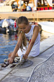 Pretty young girl near the Mediterranean sea looking forward . Antalya, Turkey, marina Stock Image