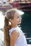 Pretty young girl near the Mediterranean sea looking forward . Antalya, Turkey, marina Royalty Free Stock Photo