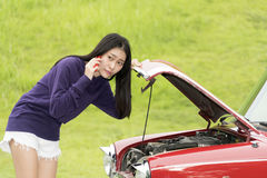 Pretty young girl need help when the car tumble down Royalty Free Stock Photos