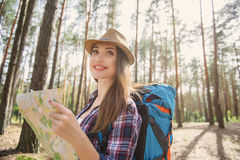 Pretty young girl orienting in forest Royalty Free Stock Images