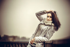 Pretty young girl outdoor on the old bridge Royalty Free Stock Images