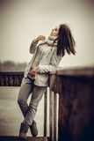 Pretty young girl outdoor on the old bridge Stock Photos