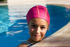 Pretty young girl in the outdoor pool. Pretty young girl in the pool Stock Photos