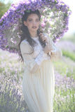 Pretty Young Girl Outdoors in a Lavender Flower Field Stock Photo