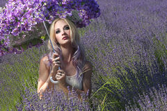 Pretty Young Girl Outdoors in a Lavender Flower Field Royalty Free Stock Photo