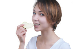 Pretty young girl with piece of green apple Royalty Free Stock Image