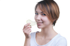 Pretty young girl with piece of green apple Royalty Free Stock Photos