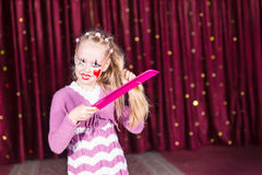 Pretty young girl in a pink pantomime costume Stock Images