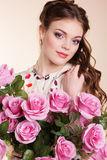 Pretty young girl with pink roses Royalty Free Stock Images