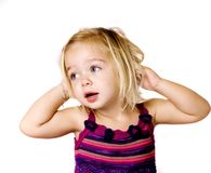 Pretty young girl playing with her hair Royalty Free Stock Photography
