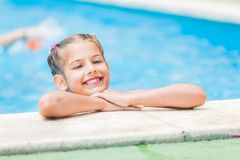 Pretty young girl at pool. Pretty young smiling girl near a side of the pool Stock Photos